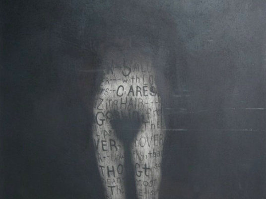 Obscured female form with words