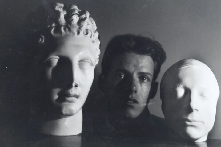 James Merrill with Mask of Keats and Bust of Hermes. Courtesy Washington University in St. Louis Special Collections.