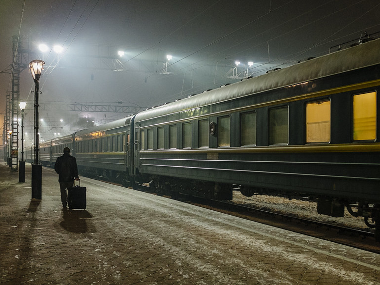 A photograph of a train station in Russia at night.