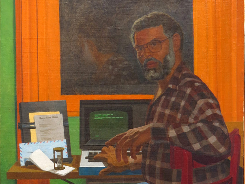 Portrait of Samuel Delany at his desk turning to look over his shoulder