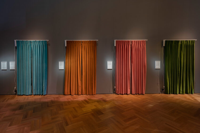 Series of four curtains in blue, yellow, pink, and green