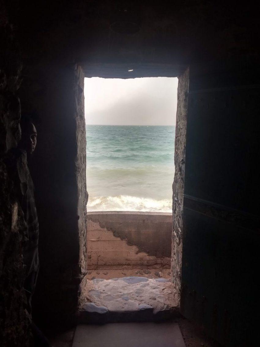 image of door of no return looking out onto ocean