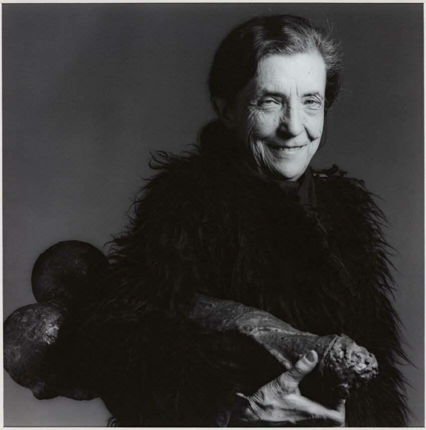 Black and white portrait of Louise Bourgeois holding Filette.