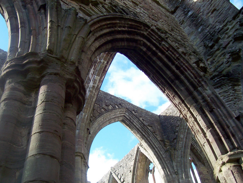 Detail of Tintern Abbey with sun shining through roof