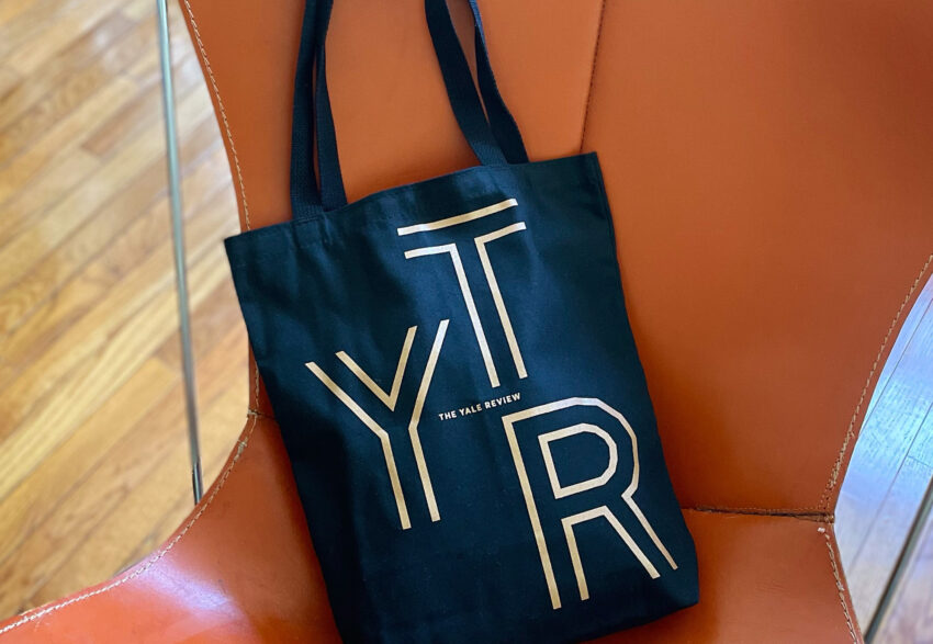 A Yale Review tote bag on a chair.