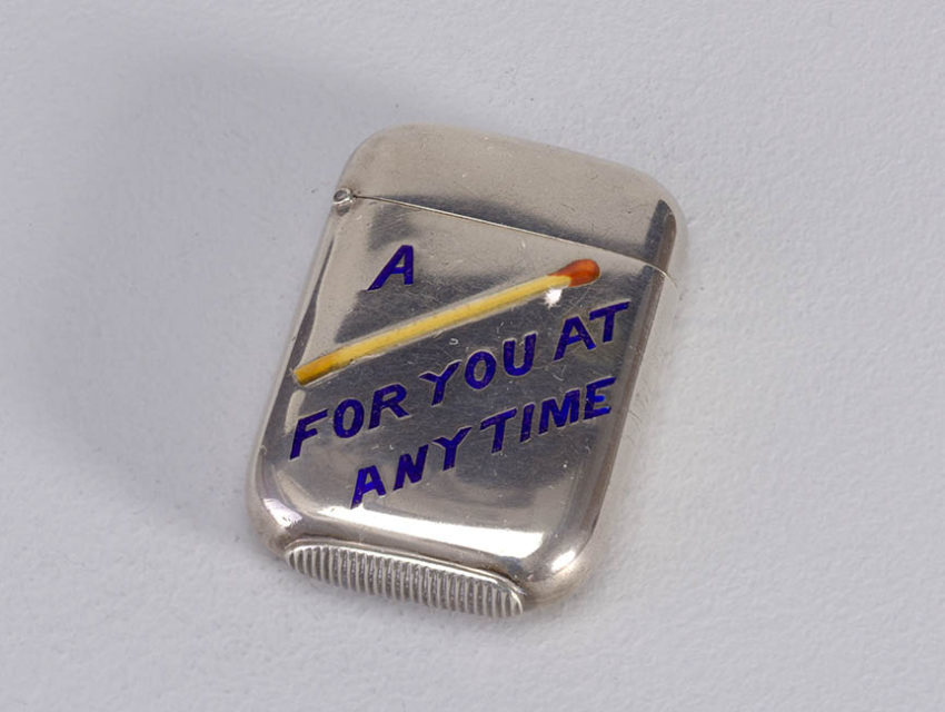 """photograph of metal match box with """"a [image of a match] for you at any time"""" printed on the front"""