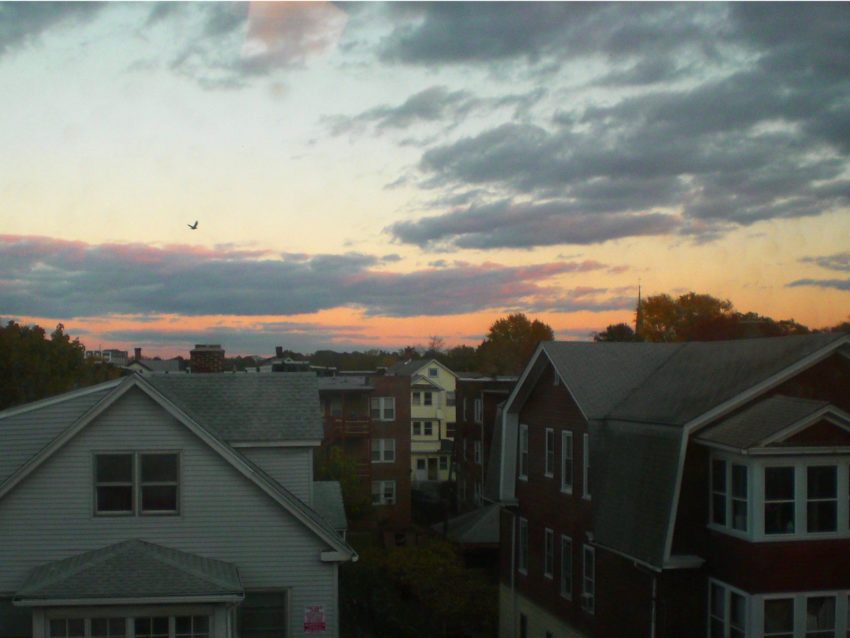 Picture of multiple buildings and houses at sunset