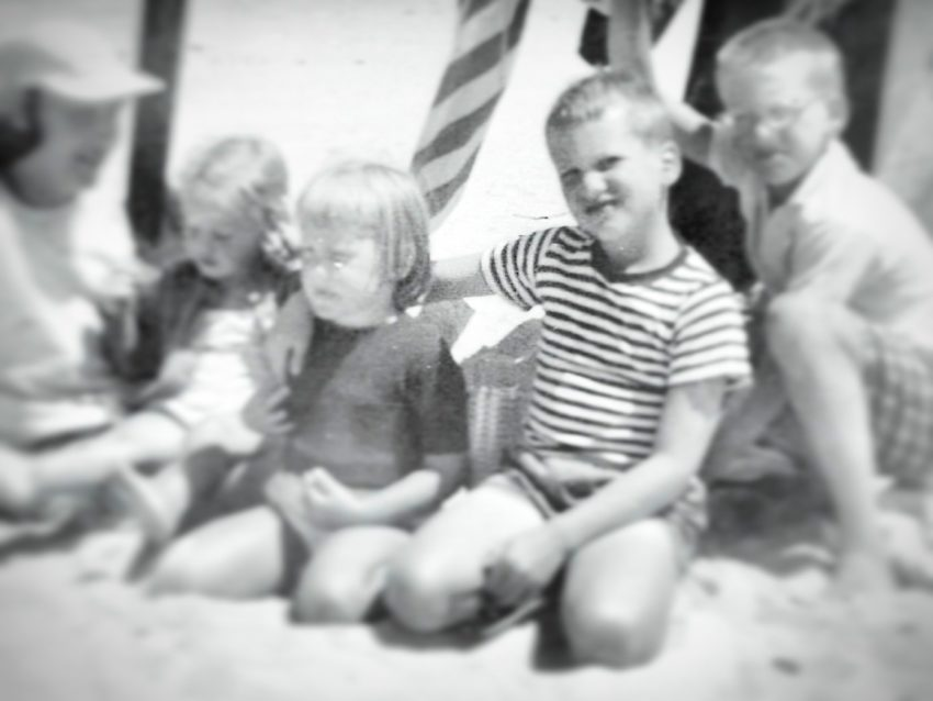 A photo of the author and her brother, with other children