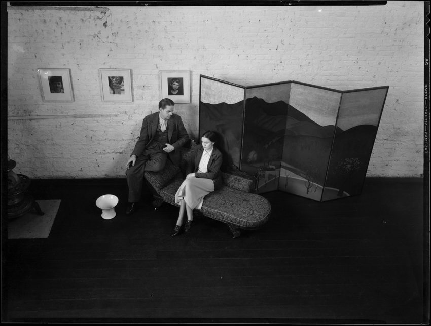 A man and woman talking on a sofa