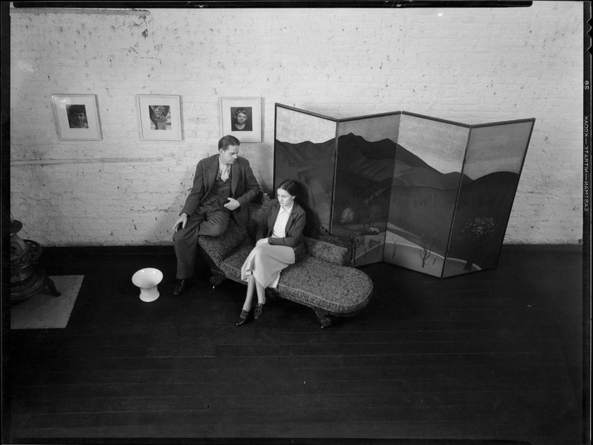 An older photo of two people sitting together
