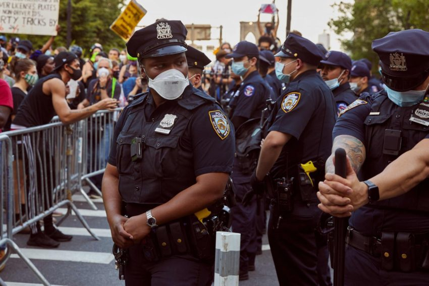Police officers beside protestors