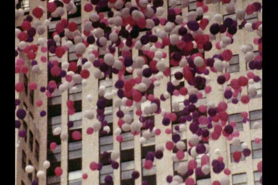 Release of pink and white balloons.