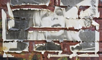 A weathered poster of Chelsea Manning