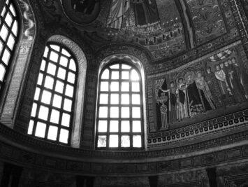 Black and white photo of light coming through windows in the apse of San Vitale in Ravenna with mosaics. Courtesy N.P. Sullo.