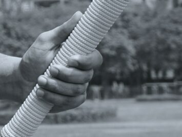 hand holding a cricket mallet.  Photo: Yogendra Singh.