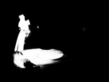 Shadowy white figure on a black ground. Detail from Jose Chavvary / Creative Commons.