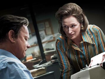 Scene from movie, The Post. Meryl Streep looks at Tom Hanks.