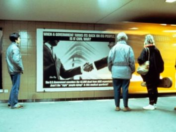 3 people at sign. When a Government Turns Its Back..., 1987-95. Courtesy The New York Public Library Digital Collections, NY.