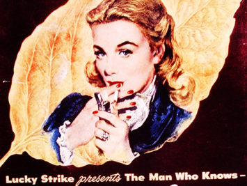 An old advertisement for Lucky Strike in which a blonde woman lights a cigarette.