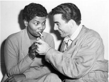 Louie Bellson lighting Pearl Bailey's cigarette