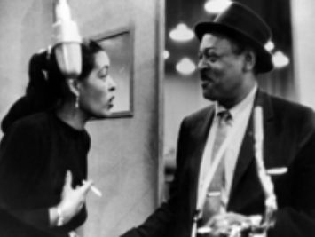 Lester Young and Billie Holiday talk to each other. Credit:  Lester Young and Billie Holiday, public domain.