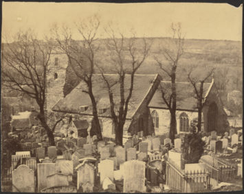An old photograph of a churchyard cemetery. Courtesy The J. Paul Getty Museum, Los Angeles.