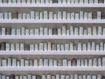 A wall of pottery. A Change in the Weather by Edmund de Waal, 2007.