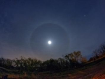 A photo of the moon in the night sky. Photo by David Dehetre.