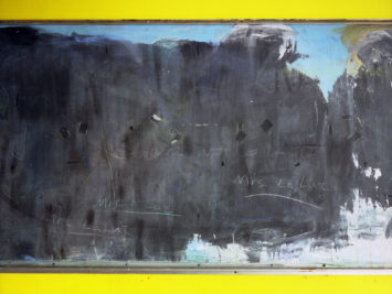 chalkboard with yellow line along top and bottom