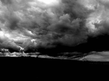 black and white photo of low and heavy clouds