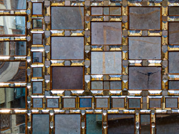 various sizes of metallic squares with gold borders